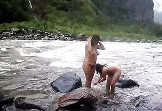 Two Indian mature womens Bathing in sea bare